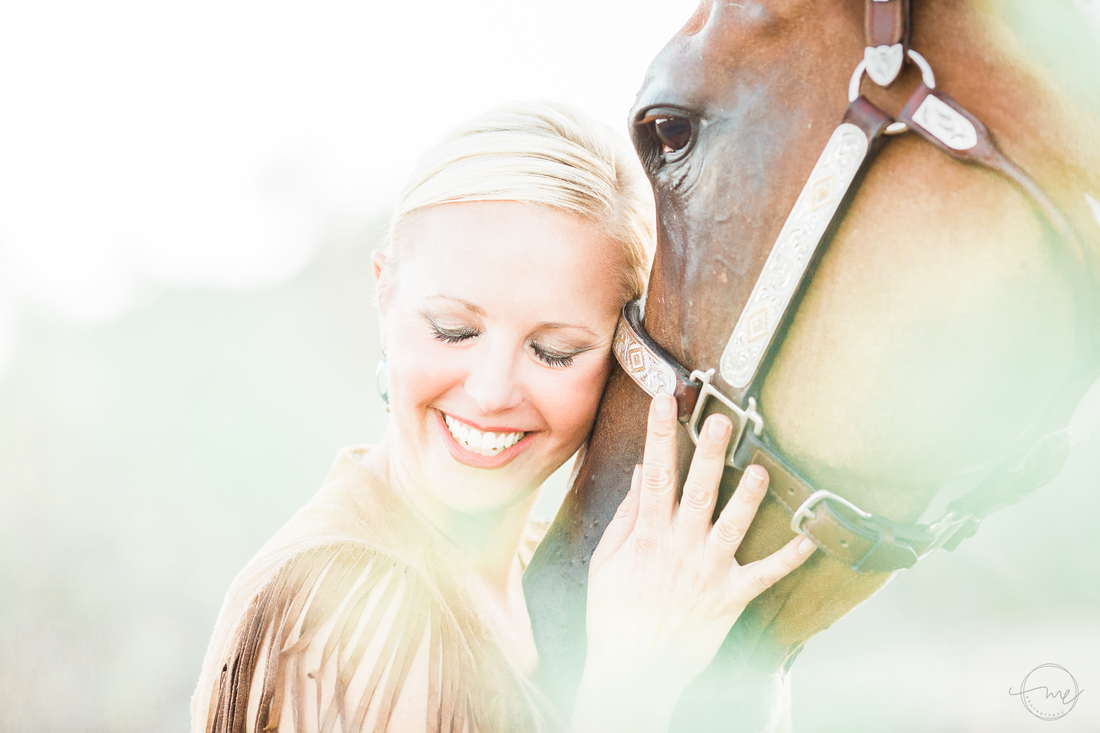 Author Carly Kade poses with her horse for Melanie Elise Photography